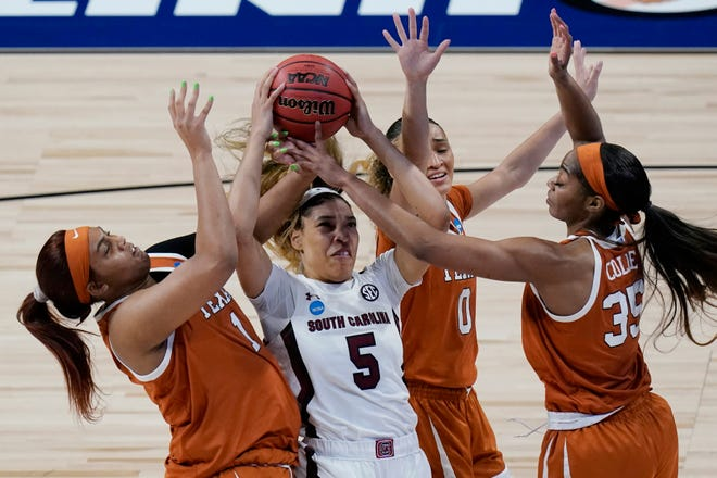South Carolina forward Victaria Saxton (5) battles Texas defenders Lauren Ebo (1), Celeste Taylor (0) and Charli Collier (35) for a rebound during the first half of the Gamecocks' 62-34 win Tuesday in the Elite Eight at the Alamodome in San Antonio.