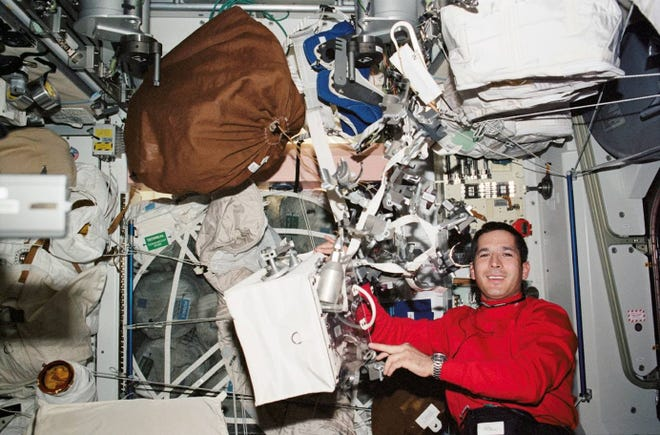 John Herrington, a member of the Chickasaw Nation, aboard the space shuttle Endeavor.