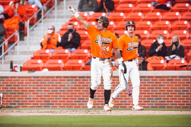 OSU third baseman Christian Encarnacion-Strand celebrates after scoring a run against Bedlam rival OU last month.