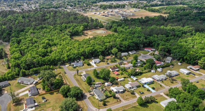 This aerial view looks south at the proposed Deer Path North subdivision Phase Two expansion property, the forested area to the south and west of Ocala Heights, which is pictured in the foreground. The area is south of Northeast Seventh Street, also known as County Road 314, where Northeast 68th Court dead ends. In the very top of the photo, the cleared land is Deer Path North Phase One.  Construction has been underway for months.