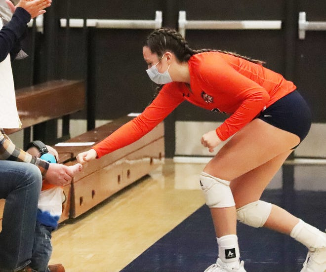 Pontiac volleyball player Ellie Wright gives a good-luck fist bump to Hudson Earney, son of PTHS head coach Haley Fairfield and Mark Earney before Tuesday's match.
