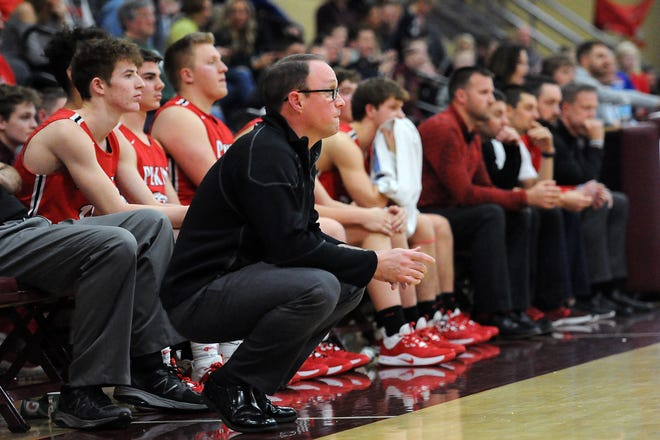 Pekin boys basketball coach Jeff Walraven watches the action during a January 2020 game at Dunlap.