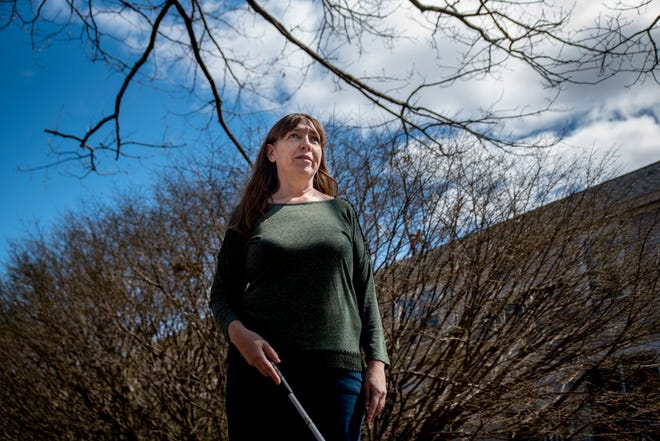 Stephanie Hurd, an assistive technology and activities specialist for Future in Sight, poses for a portrait near her home in Portsmouth, New Hampshire, on March 27, 2021. During the COVID-19 pandemic, Hurd has modified the programming she organizes for youths who are blind or visually impaired.