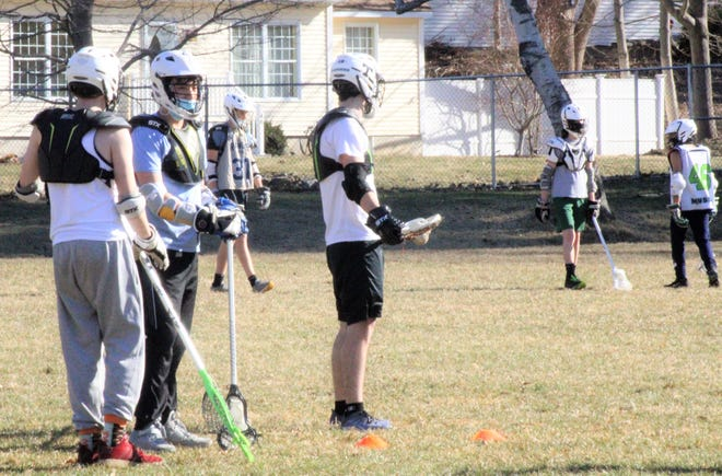 Members of the Traip Academy boys lacrosse team practice Tuesday afternoon at Emery Field in Kittery, Maine. This is the first year that Traip will have varsity boys and girls lacrosse teams.