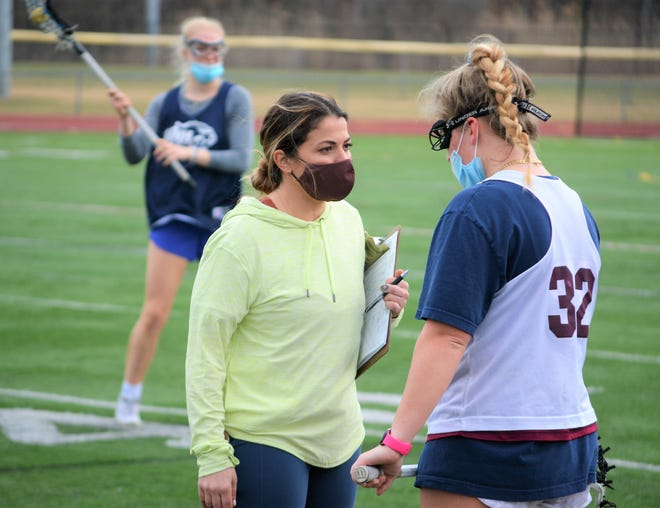 Portsmouth High School girls lacrosse coach JoJo Curro, center, talks to Ellie Seefried during Wednesday's practice. Curro was hired by the Clippers in the summer of 2019 and she's looking forward to her first year as head coach.