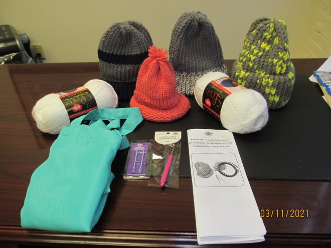 A selection of knit hats made with loom knitting kits like this one.