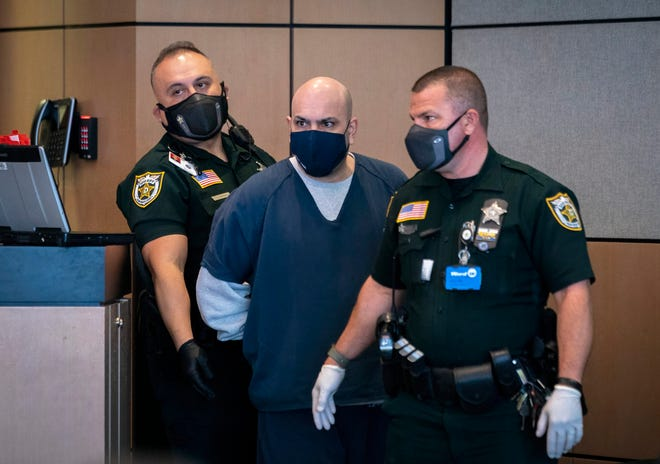 Alejandro Aleman, accused of starving his 13-month-old daughter in 2016, arrives for his plea bargain at the Palm Beach County Courthouse in West Palm Beach, Florida on March 31, 2021.