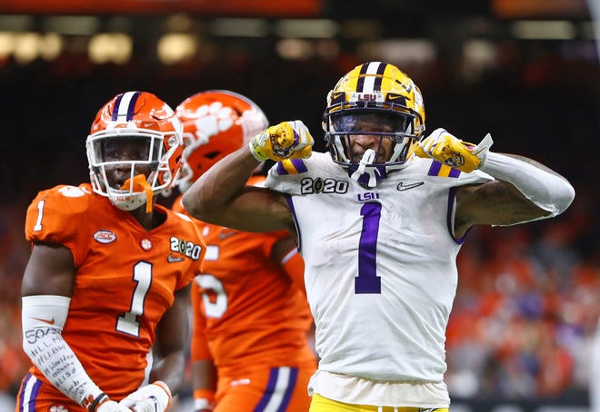 LSU Tigers wide receiver Ja'Marr Chase (1) celebrates a play against the Clemson Tigers.