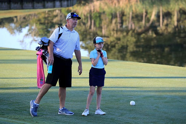 Reese McMillan, right, prepares to play her drive during a regional round of The Drive, Chip and Putt Championship at TPC Sawgrass on September 28, 2019 in Ponte Vedra Beach, Florida.