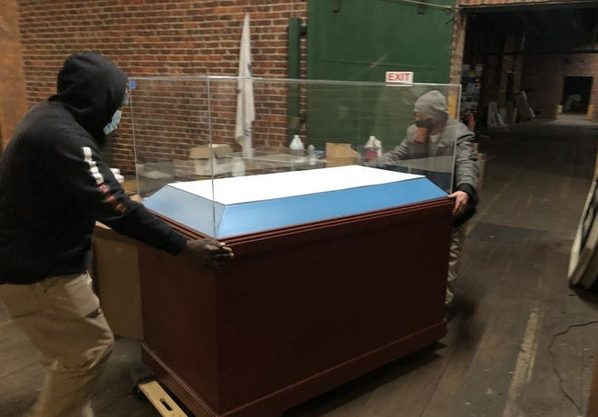 Quality Moving staff load a VMFA display case onto a truck at the Virginia Holocaust Museum in Richmond to deliver to Petersburg in March of 2021.