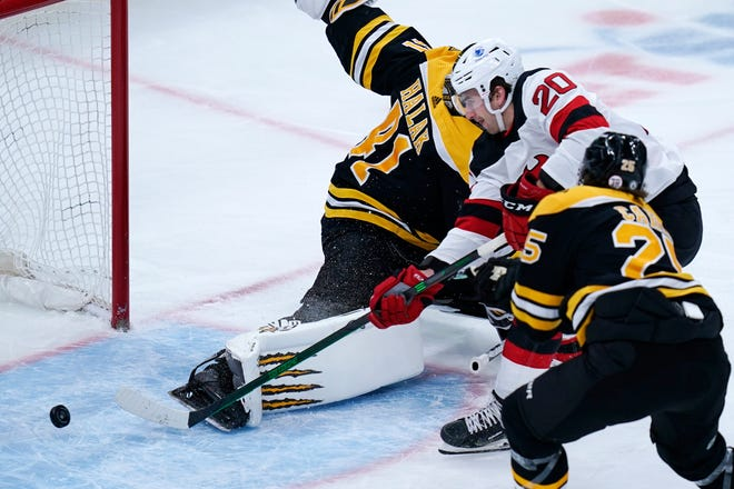 New Jersey Devils center Michael McLeod (20) beats Boston Bruins goaltender Jaroslav Halak (41) for a goal during the first period of an NHL hockey game, Tuesday, March 30, 2021, in Boston. (AP Photo/Charles Krupa)