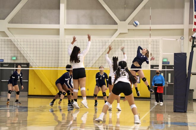Dorotea Koprivica (7) hits the ball down the left line, recording a kill during Friday night's matchup against Taft.