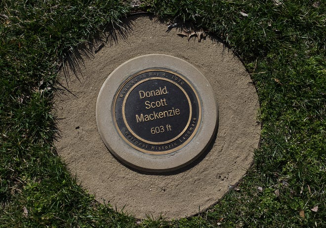 When he was shot on May 4, 1970, at Kent State University, Donald Scott Mackenzie was 603 feet away from the National Guard. He was the farthest of any of the wounded students from the guard. This marker is located on the opposite side of Midway Drive from the Prentice Hall parking lot.