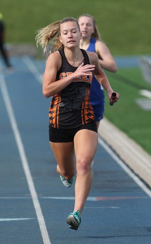 Sydney Lutz of Green anchored their 4x800 meter relay that finished first during their meet at Lake on Tuesday, March 30, 2021.