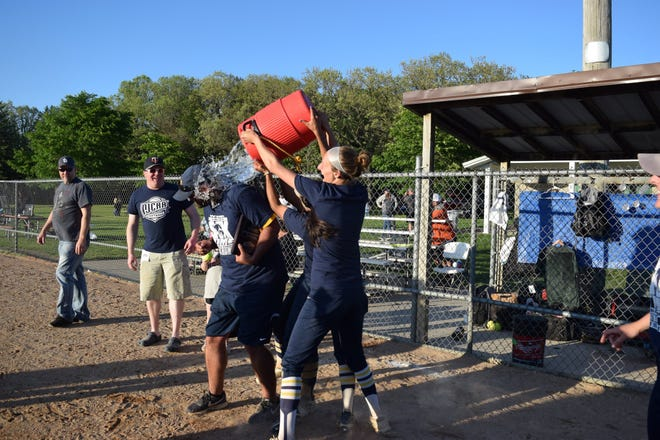 Rock Valley College softball head coach Darin Monroe gets doused by some of his players after securing his 400th career victory, a 21-0 rout, Tuesday in Rockford.