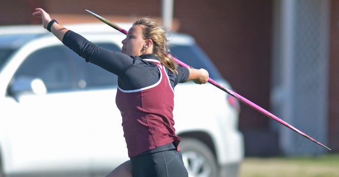 Reagan Geihsler runs and releases the javelin for a distance of 118-feet 9-inches during the Saline County Invitational track meet on Tuesday at Salina Stadium. Geihsler received first place in the girl's javelin throw.