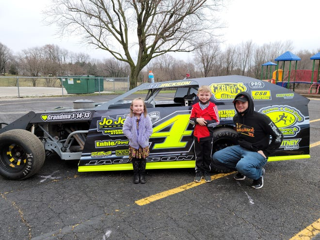 Kewanee's T.J. Jackson poses with Belle Alexander students Maggie Murphy and Oakley Murphy after a recent visit to the school.