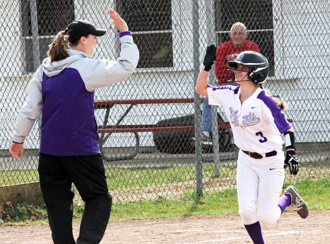 Three Rivers coach Kendra Kutz high-fives Macy Ivins after she rounds third base on Kali Heivilin's home run.