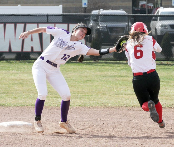 Three Rivers shortstop Kali Heivilin tags out a Coldwater base runner before she gets to second base on a steal attempt Tuesday.