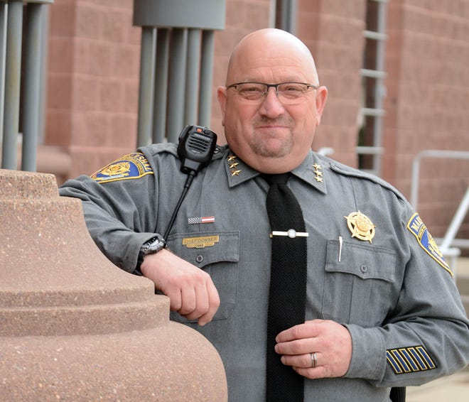 Russell Downer, Jr., 57, chief judicial marshal at Danielson Superior Courthouse, retired Wednesday after 27 years of service.