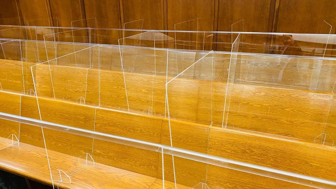 Plexiglass barriers installed in a Wichita courtroom for jury trials. Such trials were being paused for a long time due to the pandemic and have put speedy trial statutes in jeopardy.