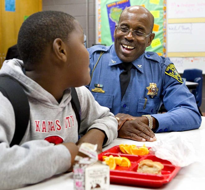 Former Shawnee County Sheriff Hermann Jones and his little, then-sixth-grader Te'Rahn Jones, chat over lunch at Eisenhower Middle School in 2014. After a year in which some recruitment activities were slowed down by the pandemic, Big Brothers Big Sisters of Kansas North Area is looking for new volunteers to serve as Bigs to children in its program.