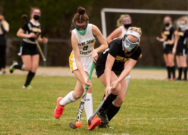 St. Paul's Alex Selvitelli, right, makes a fine defensive move on Notre Dame Academy's Delaney Wojnarowicz during a field hockey game last week.