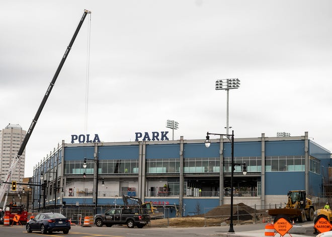 WORCESTER - Work continues on the Polar Park sign on Wednesday, March 31, 2021.