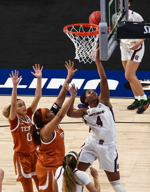 South Carolina forward Aliyah Boston goes strong to the basket during the first quarter against Texas Longhorns in a regional final Tuesday night in San Antonio.