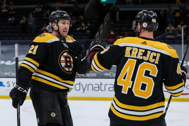Bruins left wing Nick Ritchie, left, celebrates with David Krejci after scoring against the Devils during the first period at TD Garden.
