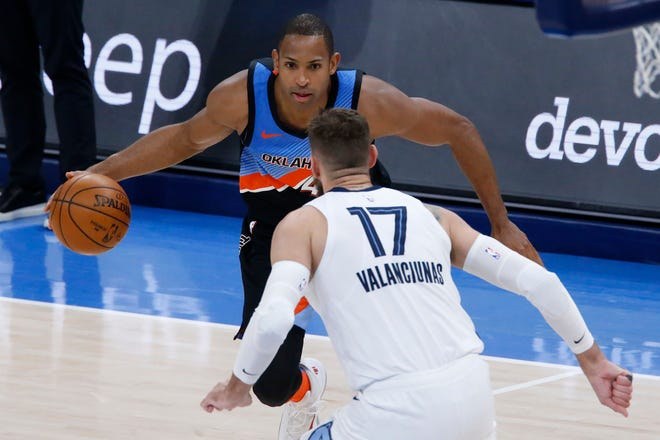 Oklahoma City Thunder center Al Horford goes against Memphis Grizzlies center Jonas Valanciunas during the second half of the NBA game on March 24 in Oklahoma City.