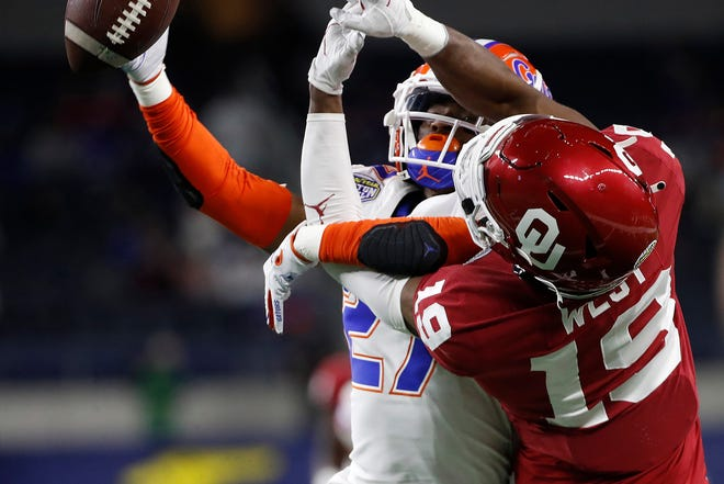 Florida defensive back Jahari Rogers (27) breaks up a pass intended for Oklahoma receiver Trevon West during the Cotton Bowl  on Dec. 30, 2020, in Arlington, Texas. Oklahoma beat Florida, 55-20.