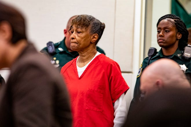 Anna Young walks into court for a case management hearing in September 2018. Young, who ran a religious boarding house south of Gainesville, was been described as a cult leader and once bathed a child in chemicals, has died in prison.