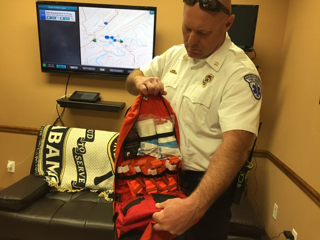Wil Reed, EMS chief of the Gadsden Fire Department, displays an advanced bleeding control trauma kit in a file photo. Reed on Tuesday was named the department's new chief.