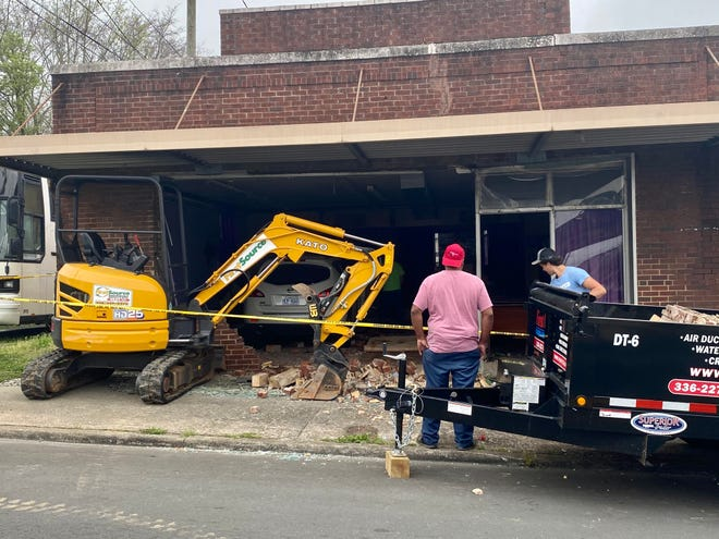 The vehicle that crashed into Gates of Zion Church in Burlington Tuesday night was still inside the building as crews cleaned up the rubble the following morning.