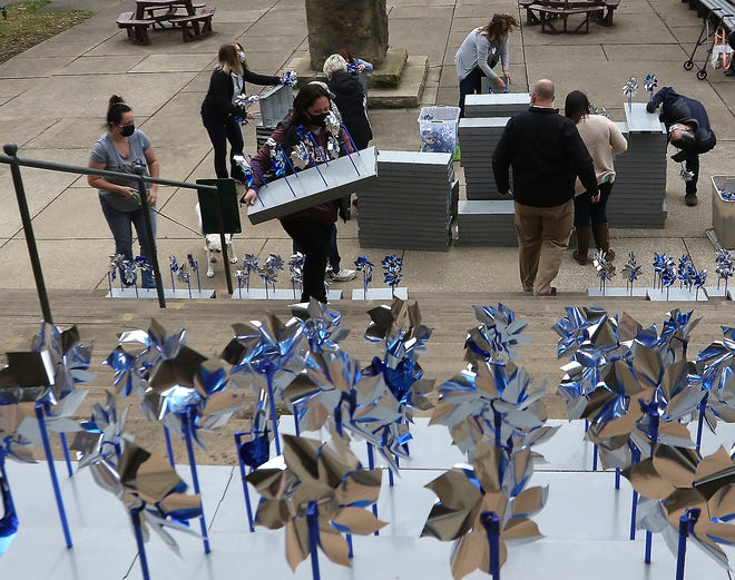 Volunteers placed the pinwheels on the steps of the Tuscarawas County courthouse Wednesday in recognition of the 15th annual Pinwheels for Prevention, for the Child Abuse Prevention Month in April.