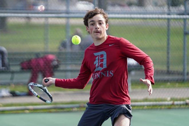 Dover's Ian Bleininger keeps his eye on the ball in 1st singles play.
