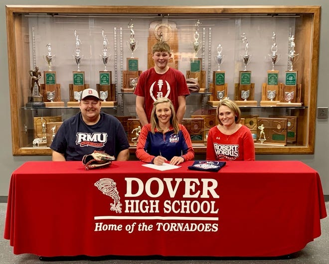 Madison DeVault is all smiles  at her signing day to play at Robert Morris University.