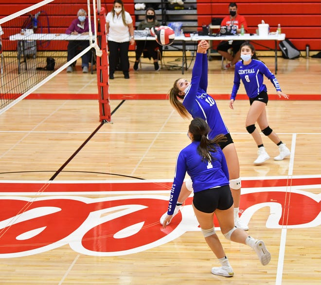 Pueblo Central senior Alicia Lest, middle, contorts for a mid-volley return in the Wildcats' three-set sweep on the road Tuesday, March 30, 2021, at Pueblo Centennial High School.
