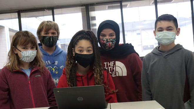 Students in Fort Smith Public School will continue to wear masks through the end of the school year. These students attend Ramsey Junior High.