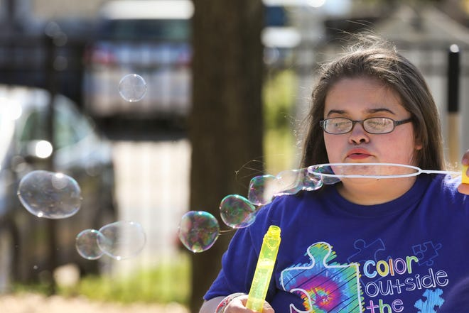 Ella Campbell joins other students in the Arts 'n Autism program as they blow bubbles in recognition of World Autism Awareness Day at the facility in Tuscaloosa Tuesday, April 2, 2019. [Staff Photo/Gary Cosby Jr.]