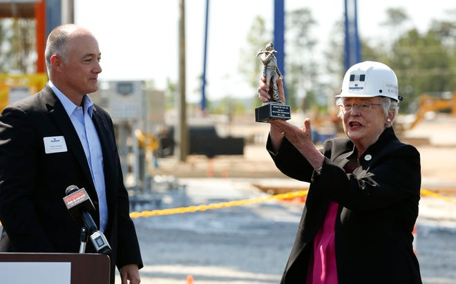 In 2018, Warrior Met Coal celebrated the opening of a new mine portal at the No. 7 North Mine facility near Brookwood with company CEO Walt Scheller, left, presenting a small statue of a miner to Gov. Kay Ivey. Now, the United Mine Workers of America have announced the company's approximately 1,100 miners will strike over unfair labor practices. [Staff file photo/Gary Cosby Jr.]