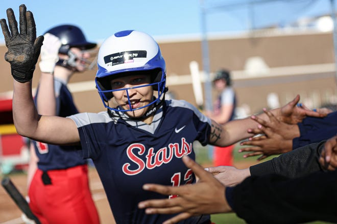 Centennial's Jazmine Singleton high-fives teammates after scoring against visiting Northland on March 29. Singleton is a sophomore third baseman for the Stars, who are led by first-year coach Alexis Marsh.