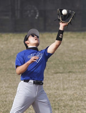 Kilbourne's Andrew Oh makes a catch during a scrimmage against Upper Arlington on March 23. In addition to playing on the infield, the junior is expected to be the Wolves' No. 1 starting pitcher.