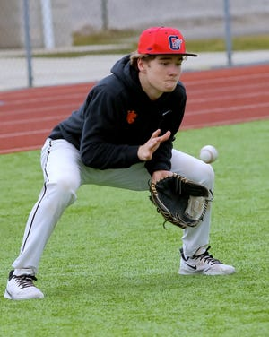 Worthington Christian's Caden Leidich fields a grounder during practice March 16. The junior is a move-in from Connecticut who is expected to see action at catcher and first base. The Warriors play April 8 at Tree of Life.