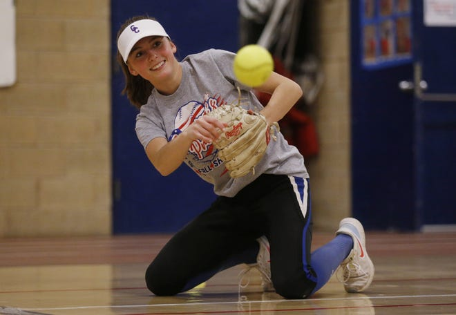 Grove City senior infielder Chloe Clark runs through a drill during practice March 15. The Greyhounds are looking to duplicate their success of 2019, when they went 21-8 and reached a Division I regional semifinal.