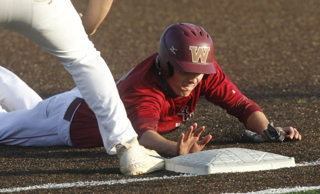 Watterson's Noah Grayem dives back to first base during a home scrimmage against Whetstone on March 24. Grayem is one of the top returnees for the Eagles. A senior infielder and pitcher, hehit .308 with 19 RBI in 2019.