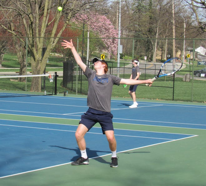 Grandview Heights senior Kieren Bode serves during a second-singles match against visiting Columbus West on March 30. Bode won 6-1, 6-3 in the 5-0 season-opening victory for the Bobcats.