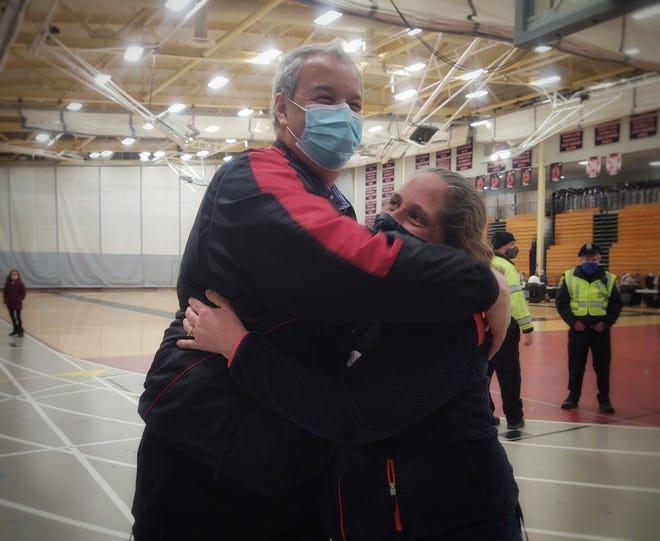 Select Board race winners Richard Vaillancourt and Janice Phillips share a hug after results showed them the winners in the North Andover Select Board race.