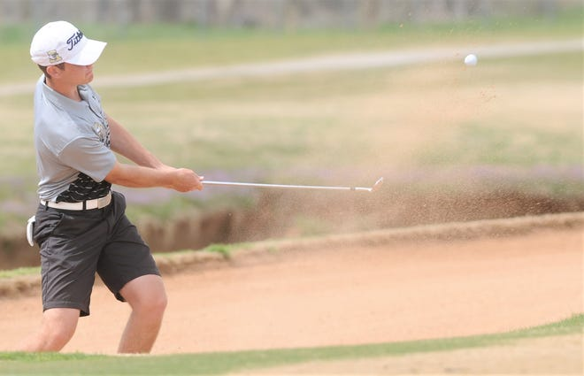 Abilene High senior Jacob Wright hits out of the sand trap at hole No. 8 at Diamondback National Golf Club.